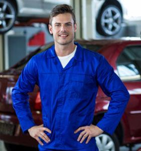 Mechanic Standing With Hands Hip Repair Shop