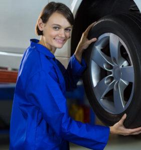 Female Mechanic Fixing Car Wheel